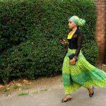 Woman walking in Arusha by Anne McKinnell