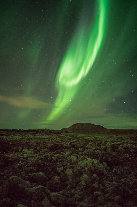 Northern Lights over Lava Field by Anne McKinnell
