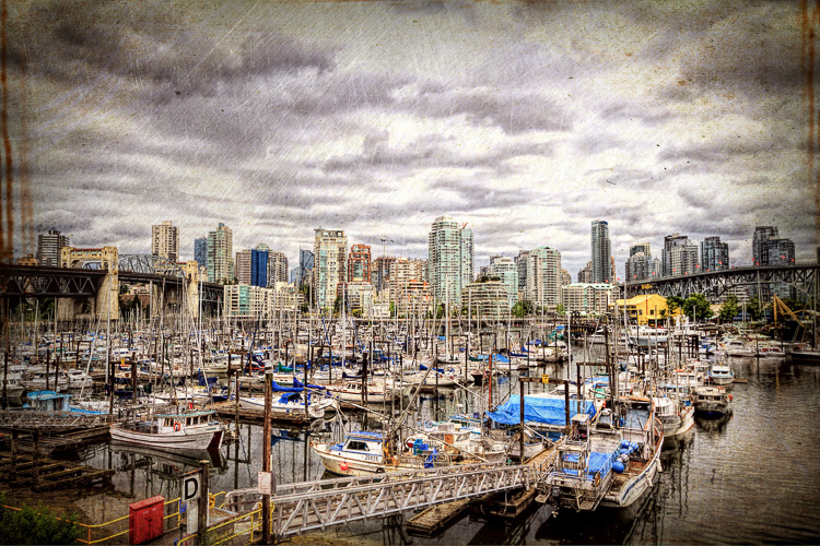 View from False Creek to downtown Vancouver including the Burrard Street Bridge and Cambie Bridge. Read the story behind the image and find out how it was made today on the blog: http://annemckinnell.com/2013/06/25/an-overcast-day-in-vancouver-bc/