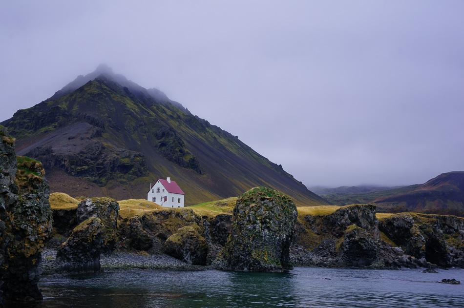 White House in Arnarstapi Harbor, Iceland by Ann McKinnell